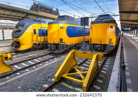 Three fast intercity trains on Central Station in Groningen waiting at the platform to leave for Amsterdam. The intercity trains are an efficient and reliable connection. - stock photo