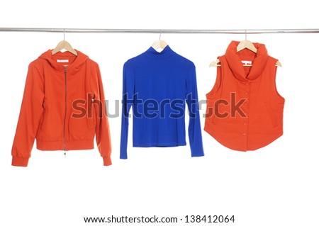 Three female dress, vest ,coat isolated on hanging - stock photo