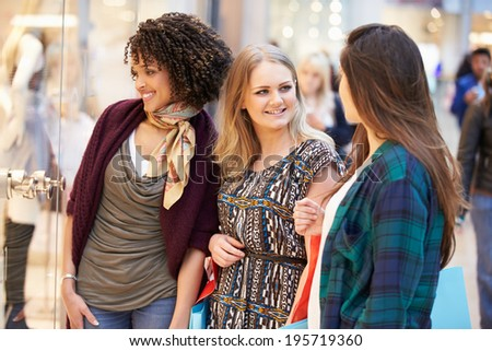 Three Female Friends Shopping In Mall Together - stock photo