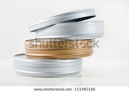 Three film tins isolated - stock photo