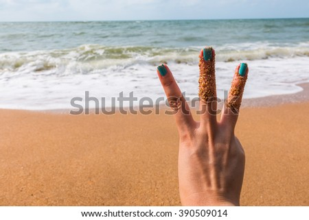 Three  fingers at the sea for background - stock photo