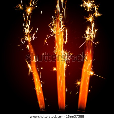 three firework sparklers with red glowing - stock photo
