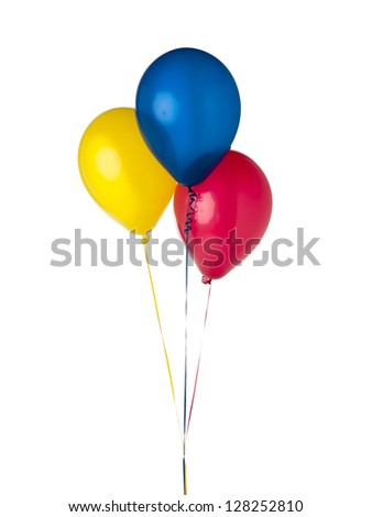 Three floating multi-colored balloons photographed.