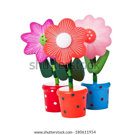 Three floppy Wooden Flower Toys isolated on white - stock photo