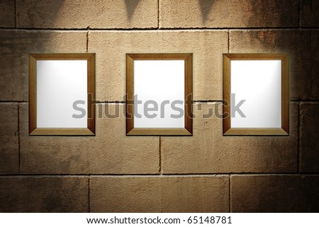 three frame with brick wall