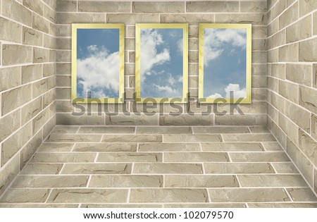 Three frames on brick wall with blue sky background - stock photo