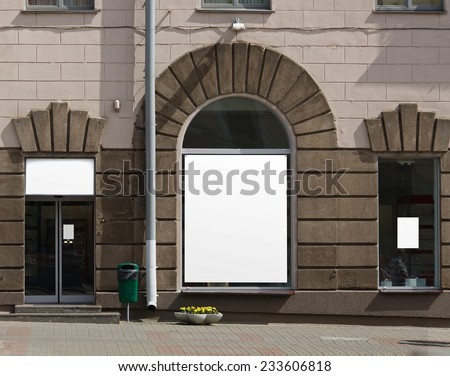 Three free advertising space on the wall of a building. Clipping path. - stock photo