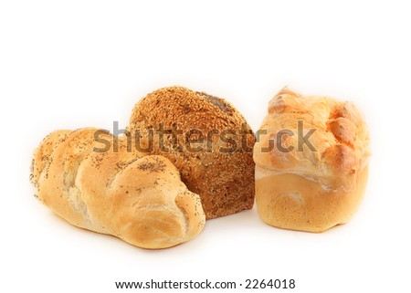 Three fresh-baked loaves of bread - one seeded, one with poppyseeds, and one high-tin floured.