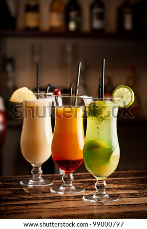 Three fresh cocktails on a bar table