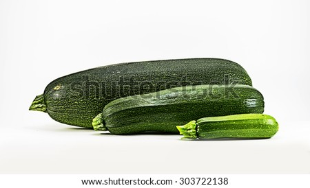 Three fresh green marrows isolated on white background