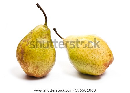 Three fresh green pears. Group of juicy ripe fruits. View of conference pear isolated on white background. - stock photo