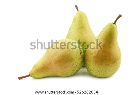 three fresh migo pears on a white background