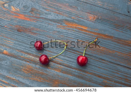 Three fresh on old wooden table. Healthy and tasty food on grey background. - stock photo