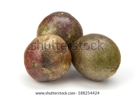 three fresh passion fruit on the white background