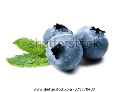 Three fresh ripe blueberries with mint leaves isolated on white background. Close up - stock photo