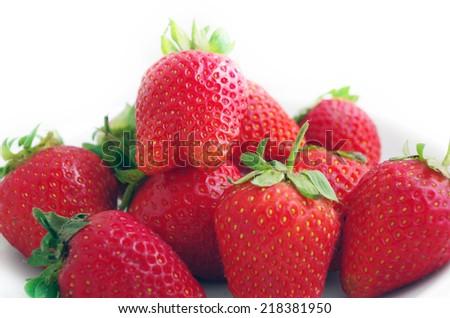 Three fresh strawberries isolated on white background.  - stock photo