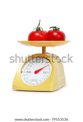 Three freshness tomatoes lying on weight scale. Isolated on white with clipping path - stock photo