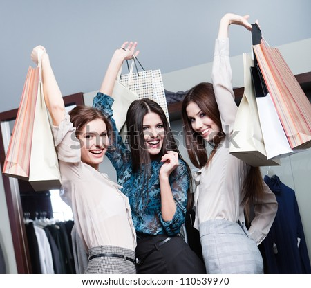 Three friends are happy after shopping - stock photo