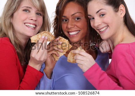 three friends eating pancakes - stock photo