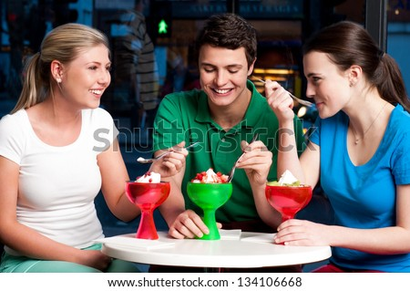 Three friends enjoying day out in a restaurant. - stock photo