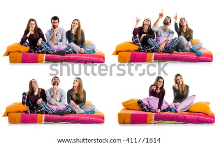 Three friends on a bed thinking - stock photo