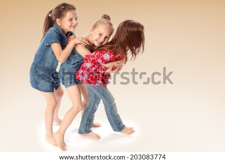 three friends playing and having fun.family joy, happy family,happiness concept,happy childhood,carefree childhood,active lifestyle - stock photo