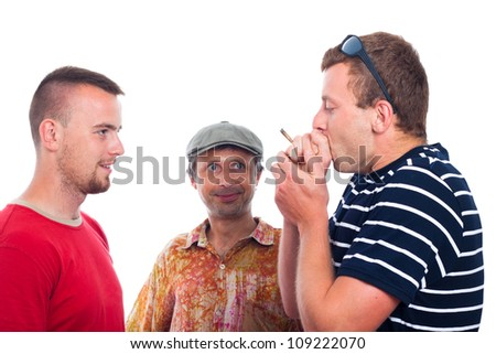 Three friends smoking hashish joint, isolated on white background. - stock photo