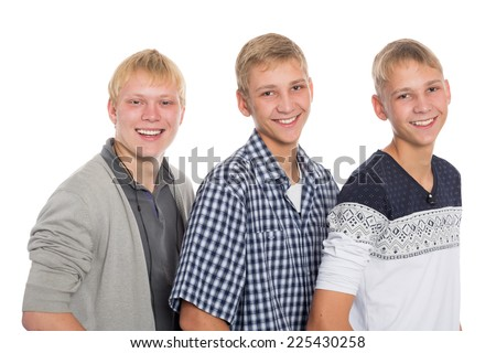 Three friends - two twin brothers and their friend the same age. - stock photo