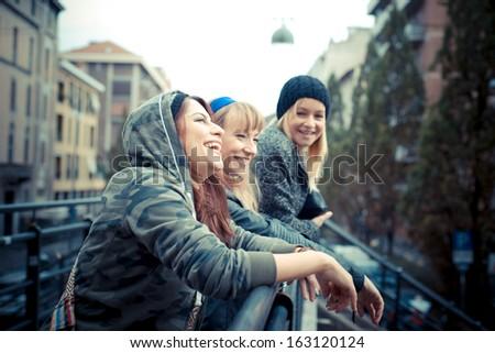 three friends woman in urban contest - stock photo