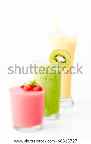 Three fruit smoothies with focus on centre glass, shallow depth of field