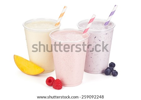 Three Fruity Yogurt Smoothies Isolated on White Background with Fruit Garnishes and Striped Straws