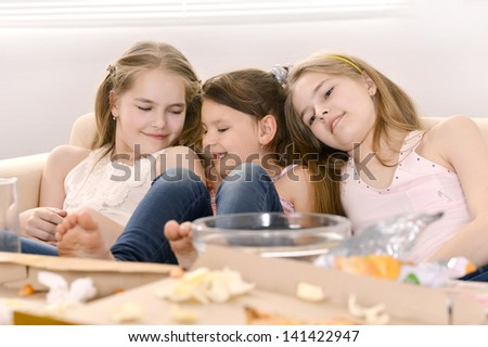 Three fun young girls relaxing at home together