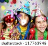 Three funny carnival kids portrait enjoying together. - stock photo