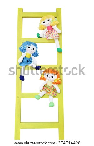 Three funny doll on a wooden ladder isolated on white - stock photo