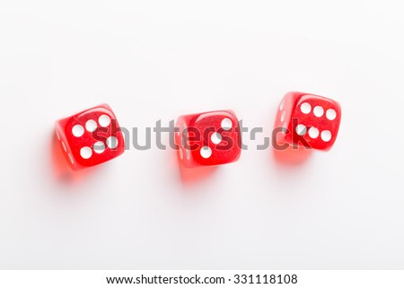 three gabling dices on white surface - stock photo