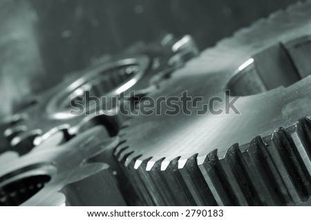 three gears connecting in a blue-metallic tone