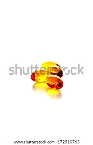 Three gel capsules isolated.