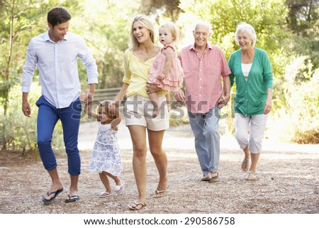 Three Generation Family On Country Walk Together - stock photo