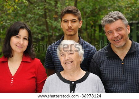 Three generation happy smiling family - stock photo