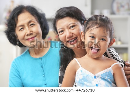 Three generation of Asian females posing at home starting from grandma, mother and daughter - stock photo