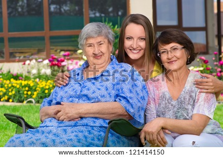 Three generation of women at countryside together - stock photo