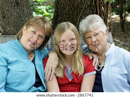 Three generations - a little girl, her mother, and her grandmother.  All with blond hair and blue eyes.