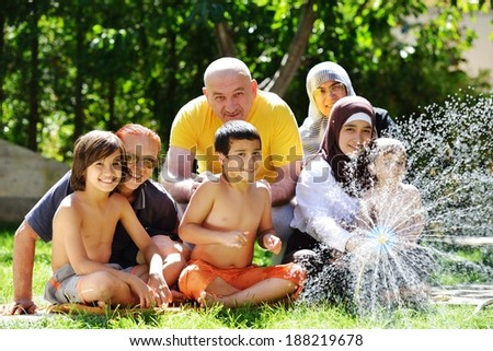 Three generations family having fun happy time with water by the summer time - stock photo