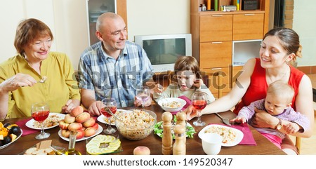 three generations family having lunch at home interior