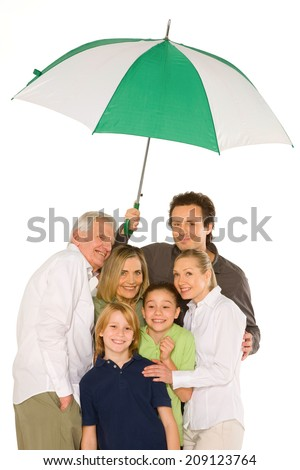 three generations family standing isolated on white background holding umbrella - stock photo