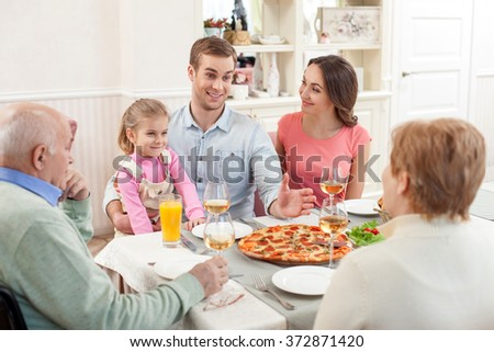 Three generations have dinner together