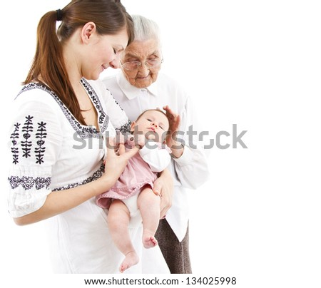 three generations of a family: baby, mother and great-grandmother - stock photo