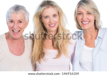 Three generations of  cheerful women smiling at camera on white background - stock photo