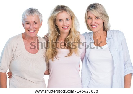 Three generations of  happy women smiling at camera on white background - stock photo