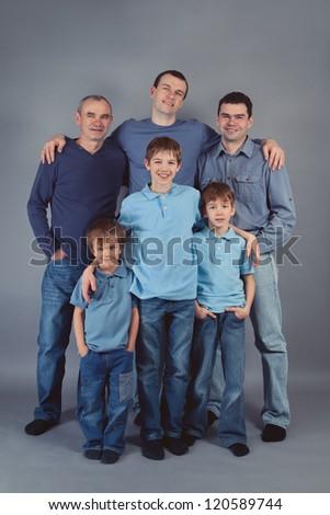 Three generations of men, indoor - stock photo
